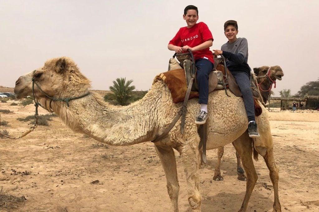 Twinning - two boys on camel