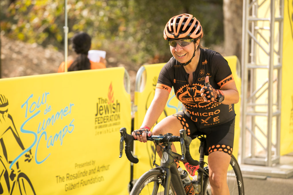 Judith Feldman Biking in Tour de Summer Camps