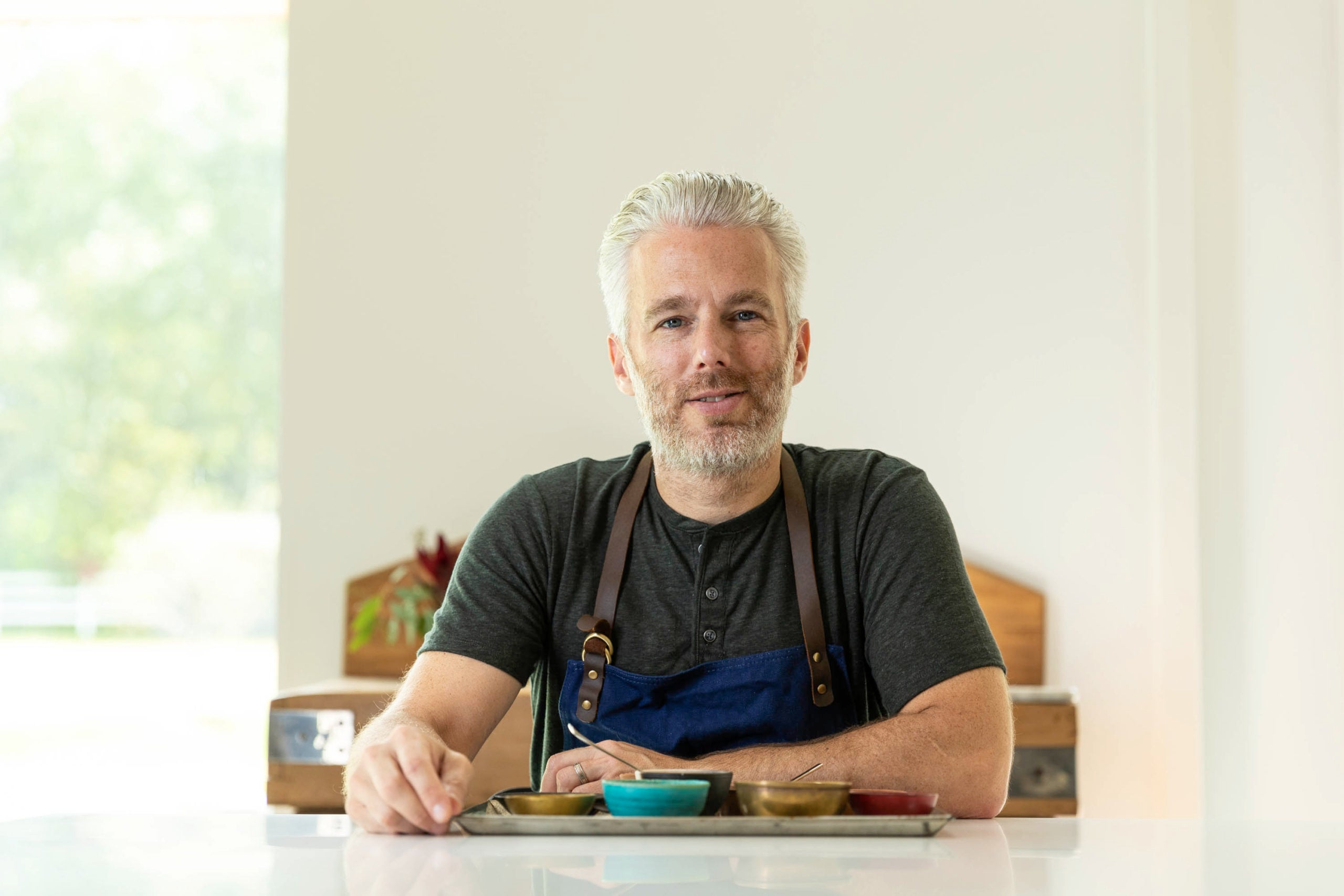 Israeli chef and spice master Lior Lev Sercarz is sitting at a kitchen counter